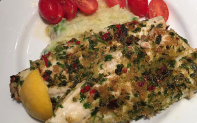 Herb-crusted panfried sea bass fillets with champ