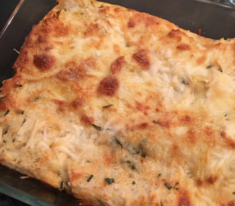 Savoury bread pudding baked with cheese and spinach
